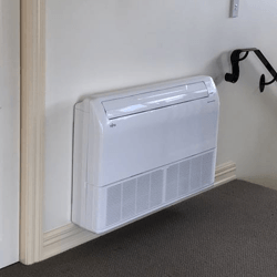 White floor mounted air conditioner near stairs