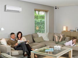 Family rests in the living area with Heat Pump