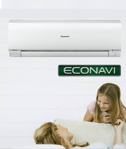 Mother and daughter lying in sofa near Panasonic air conditioner