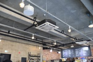 A ceiling mounted air conditioning unit in a commercial space