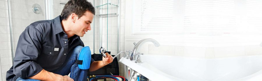 Specialist s fixing the issue in the bathroom
